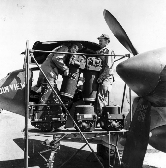 Engineers fit cameras into a reconnaissance variant of the P-38