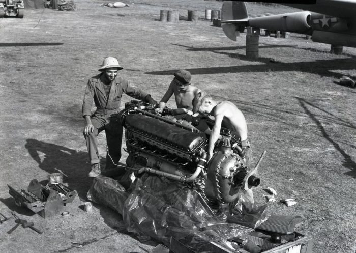 Mechanics work on an Allison V-1710 V12 engine from a P-38. This engine was well liked and performed great in the P-38, but is often regarded as inferior to the Rolls-Royce Merlin.
