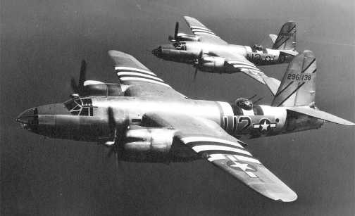 Two B-26 Marauders carrying invasion stripes.